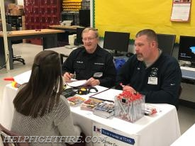 Fire Police Representative Ron Miller and Committee Chair Mike King interviewing a student interested in volunteering.